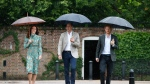 Britain's Prince William, center, his wife Kate, Duchess of Cambridge and Prince Harry arrive for an event at the memorial garden in Kensington Palace, London, Wednesday, Aug. 30, 2017. Princes William and Harry are paying tribute to their mother, Princess Diana, on the eve of the 20th anniversary of her death by visiting the Sunken Garden to honor Diana's work with charities. (AP Photo / Kirsty Wigglesworth)