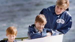 Diana, Princess of Wales, enjoys a ride on the Maid of Mist in Niagara Falls, Ontario with her sons Prince Harry and Prince William, on Oct., 1991, photo. THE CANADIAN PRESS/Hans Deryk