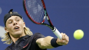 Denis Shapovalov returns to Jo-Wilfried Tsonga at the U.S. Open tennis tournament in New York on Wednesday, Aug. 30, 2017. (AP / Kathy Willens)