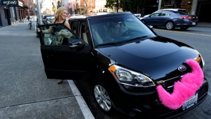 In this March 12, 2014 file photo, Katie Baranyuk gets out of a car driven by Dara Jenkins, a driver for the ride-sharing service Lyft, after getting a ride to downtown Seattle (AP / Ted S. Warren)