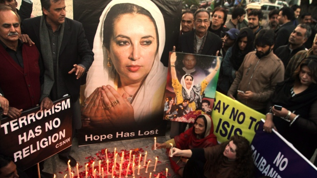 Supporters of Pakistan's slain leader Benazir Bhutto take part in a memorial in Lahore, Pakistan, Sunday, Dec. 27, 2015. Bhutto died in a gun and suicide bomb attack after addressing an election rally 2007. (AP Photo/K.M. Chaudary)