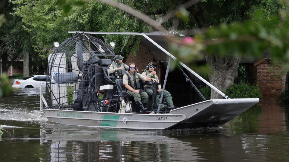 A U.S. Border Patrol air boat moves through neighborhood inundated by floodwaters from Tropical Storm Harvey in Houston, Texas, Wednesday, Aug. 30, 2017. (AP / LM Otero)
