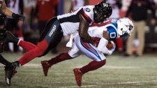 Montreal Alouettes running back Stefan Logan is tackled by Ottawa Redblacks linebacker Ron Omara during second quarter CFL football action Thursday, August 31, 2017 in Montreal. THE CANADIAN PRESS/Paul Chiasson