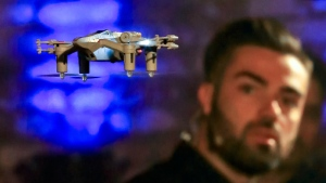 "Jack Bishop, lead pilot for Propel, demonstrates the company's new ""Star Wars"" Starfighter drone, unveiled during a media preview, in the Brooklyn borough of New York on Tuesday, Aug. 29, 2017.  (AP /Bebeto Matthews)"