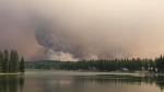 Wildfire smoke rises over Watch Lake in B.C.'s Cariboo Regional District on Thursday, Aug. 31, 2017. (Karen Brodie Smith, provided)