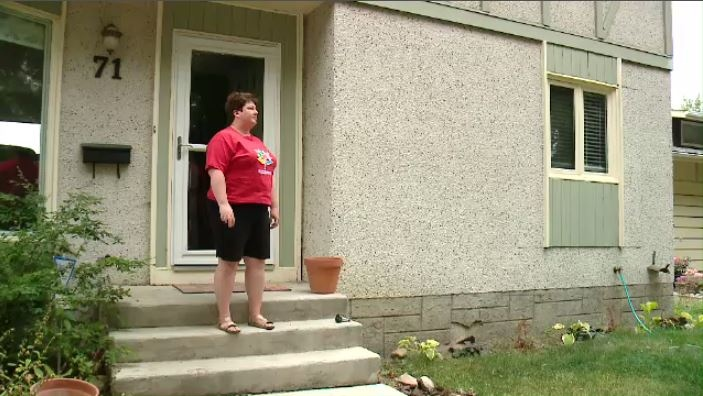 Heather Bell says she fell into a hole caused by a water main break near her home in Regina. (TAYLOR RATTRAY/CTV REGINA)