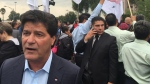 Unifor president Jerry Dias, left, takes part in a labour rally during NAFTA talks in Mexico City on Sept. 1, 2017. (Alexander Panetta / THE CANADIAN PRESS)