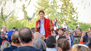 Prime Minister Justin Trudeau speaks with members of the crowd at a community event at the Kwanlin Dun Cultural Centre in Whitehorse, Yukon on Friday, Sept. 1, 2017. (Joel Krahn / THE CANADIAN PRESS)