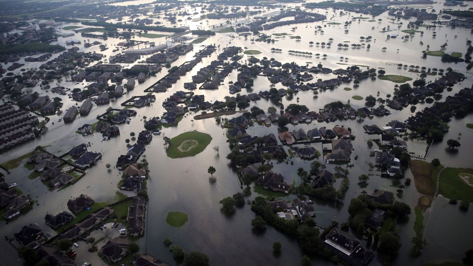 Floodwaters from Tropical Storm Harvey surround homes in Port Arthur, Texas, Thursday, Aug. 31, 2017. (Gerald Herbert/AP Photo)