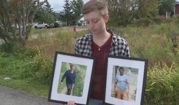 The niece of Jim Matthews, Hannah MacDonald holds up photos of her godfather Sept. 2, 2017.