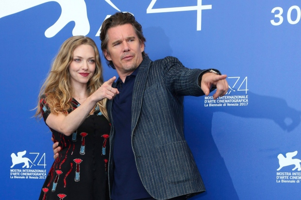 Actors Amanda Seyfried, left, and Ethan Hawke pose for photographers at the photo call of the film 'First Reformed' during the 74th edition of the Venice Film Festival in Venice, Italy, Thursday, Aug. 31, 2017. (Photo by Joel Ryan / Invision/AP)
