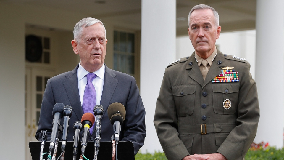 Defense Secretary Jim Mattis, left, accompanied by Joint Chiefs Chairman Gen. Joseph Dunford, right, speaks to members of the media outside the West Wing of the White House in Washington, Sunday, Sept. 3, 2017. (AP Photo/Pablo Martinez Monsivais)