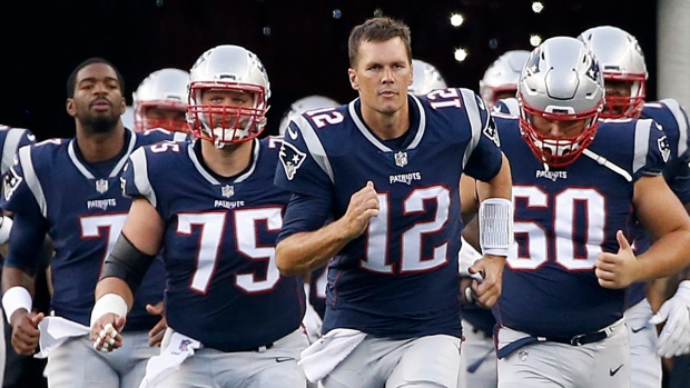 New England Patriots quarterback Tom Brady (12) leads his team onto the field during an NFL preseason football game, in Foxborough, Mass. on Aug. 10, 2017. (AP / Mary Schwalm, File)