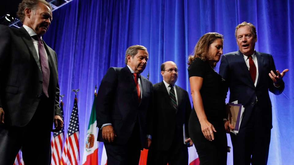 U.S. Trade Representative Robert Lighthizer, right, speaks with Canadian Foreign Affairs Minister Chrystia Freeland, second from right, as they leave a news conference, which included Mexico's Secretary of Economy Ildefonso Guajardo Villarreal, at the start of NAFTArenegotiations in Washington, Wednesday, August 16, 2017. THE CANADIAN PRESS/AP-Jacquelyn Martin