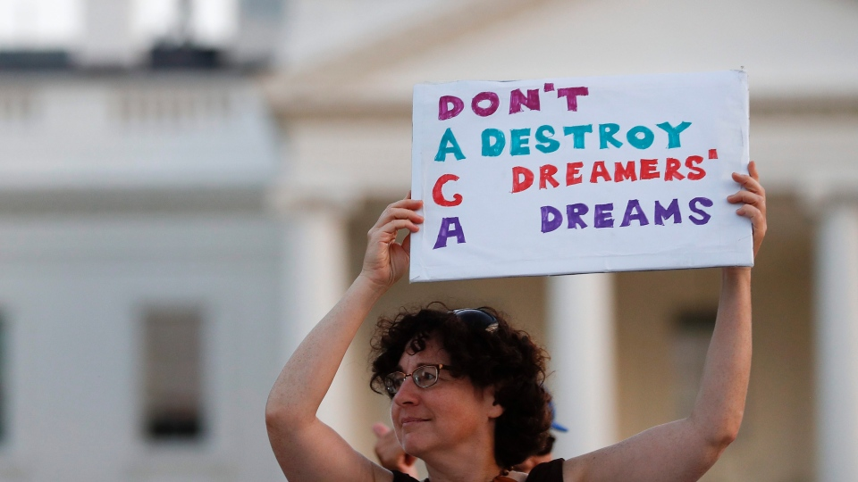 Julia Paley, of Arlington, Va., with the DMV Sanctuary Congregation Network, holds up a sign that reads 'DACA Don't Destroy Dreamers Dreams' during a rally supporting Deferred Action for Childhood Arrivals, or DACA, outside the White House, in Washington, Monday, Sept. 4, 2017.  (AP / Carolyn Kaster)