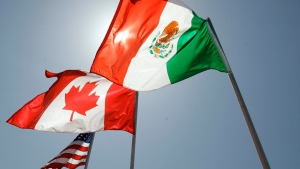 National flags representing the United States, Canada, and Mexico fly in the breeze in New Orleans where leaders of the North American Free Trade Agreement met on April 21, 2008. (AP / Judi Bottoni)