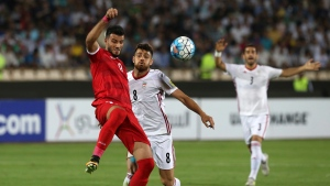 Syria's Omar Alsoma, left, vies for the ball with Iran's Morteza Pouraliganji during their Round 3 - Group A World Cup qualifier on Sept. 5, 2017. (AP / Vahid Salemi)