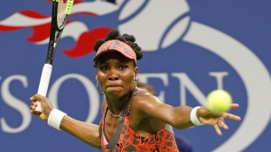 Venus Williams, of the United States, prepares to hit a forehand during the third of a quarterfinal against Petra Kvitova, of the Czech Republic, at the U.S. Open tennis tournament in New York, Tuesday, Sept. 5, 2017. (AP Photo/Kathy Willens)