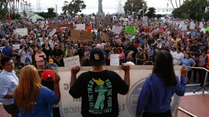 Standing on the step to the County Administration building, several groups address the crowd during a rally to show support for DACA in San Diego on Tuesday, Sept. 5, 2017. (Nelvin C. Cepeda / The San Diego Union-Tribune via AP)