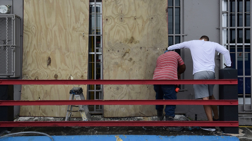 People board up windows in Puerto Rico