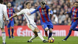 Barcelona's Lionel Messi, centre right, escapes Real Madrid's Cristiano Ronaldo at the Camp Nou in Barcelona, Spain, on Dec. 3, 2016. (Manu Fernandez / AP)