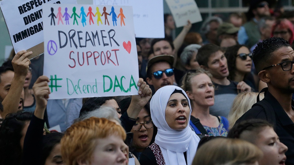 Supporters of the Deferred Action for Childhood Arrivals (DACA) yell during a protest outside of the Federal Building in San Francisco, Tuesday, Sept. 5, 2017. (AP / Jeff Chiu)