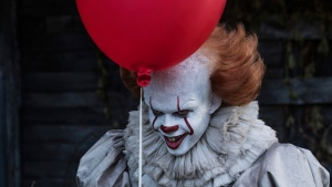 This image released by Warner Bros. Pictures shows Bill Skarsgard in a scene from 'It.' (Brooke Palmer / Warner Bros. Pictures via AP)