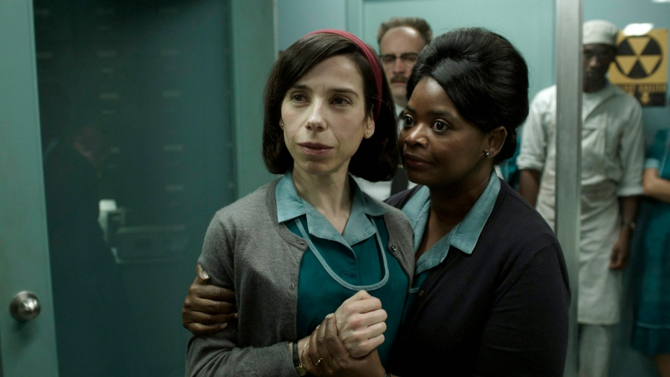 """This image released by Fox Searchlight Pictures shows Sally Hawkins, left, and Octavia Spencer in a scene from """"The Shape of Water."""" (Fox Searchlight Pictures via AP)"""