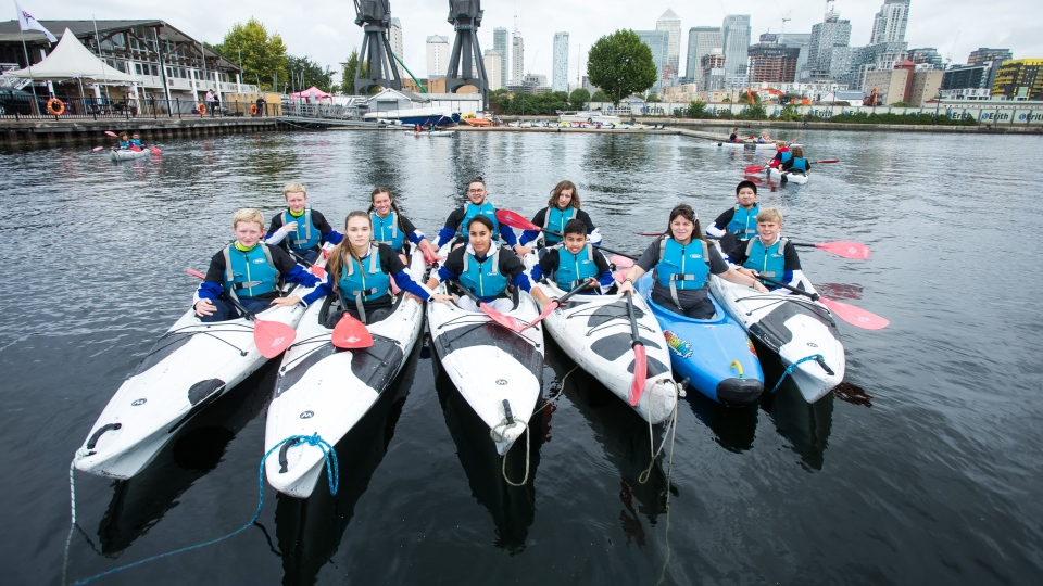 Maggie MacDonnell (in the blue kayak) taught children to kayak at the London Docklands on Sept. 6. (The Varkey Foundation)
