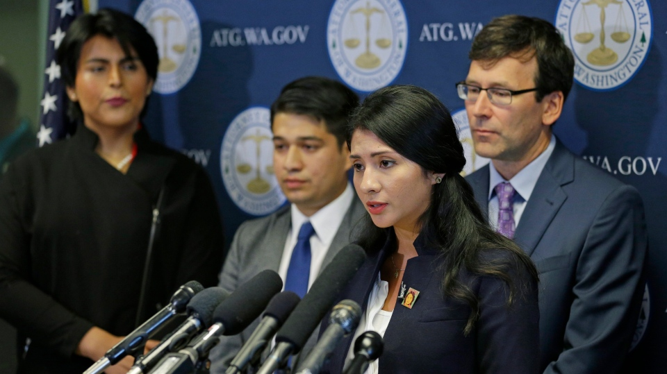 Faride Cuevas, second from right, a participant in the Deferred Action for Childhood Arrivals program, talks to reporters on Sept. 6, 2017. (AP / Ted S. Warren)