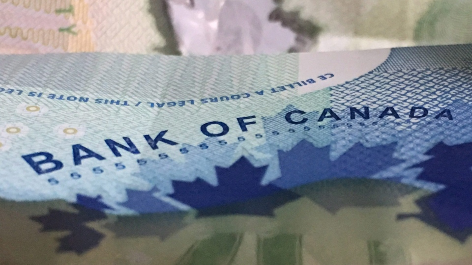 Canadian bank notes are seen Wednesday September 6, 2017 in Ottawa. (Adrian Wyld / THE CANADIAN PRESS)
