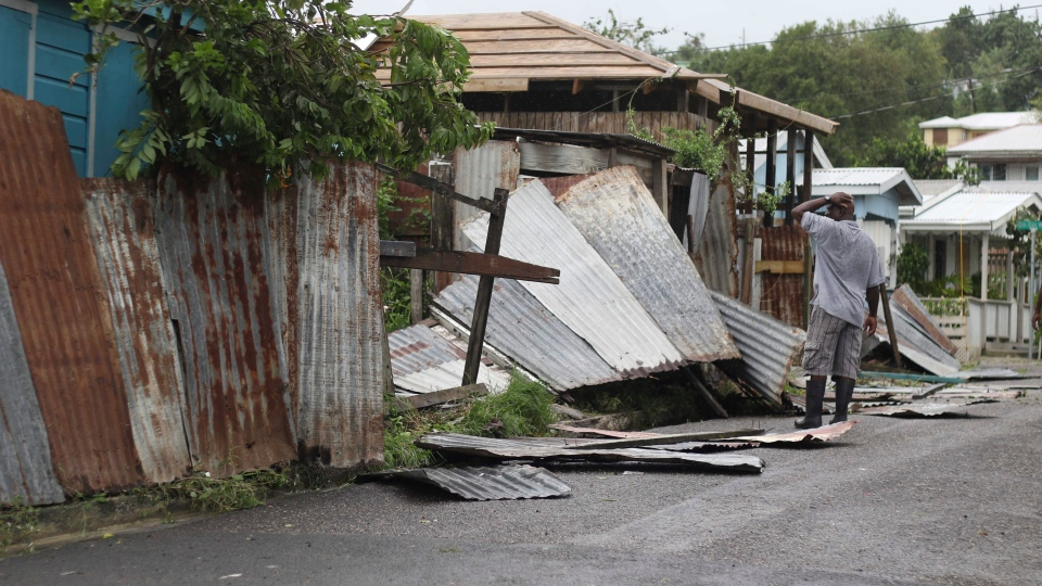A man surveys the wreckage on his property after the passing of Hurricane Irma, in St. John's, Antigua and Barbuda, Wednesday, Sept. 6, 2017. (AP / Johnny Jno-Baptiste)