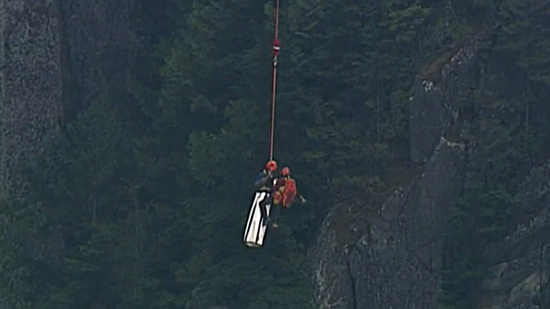 Rescuers approach a trio of climbers on the Stawamus Chief on Wednesday, Sept. 6, 2017.
