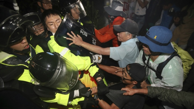 US adds launchers to THAAD as dozens hurt in SKorea protests