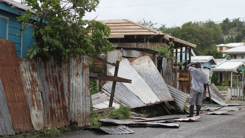 A man surveys the wreckage on his property after the passing of Hurricane Irma, in St. John's, Antigua and Barbuda, Wednesday, Sept. 6, 2017. (Johnny Jno-Baptiste/AP)