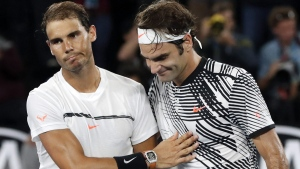 Roger Federer, right, is congratulated by Rafael Nadal after winning the men's singles final at the Australian Open, on Jan. 29, 2017. (Dita Alangkara / AP)