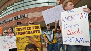 People at the Intermodal Center in Erie, Pa., protest U.S. President Donald Trump's decision to rescind former President Barack Obama's Deferred Action for Childhood Arrivals (DACA) policy on Sept. 6, 2017. (Christopher Millette)/Erie Times-News via AP)