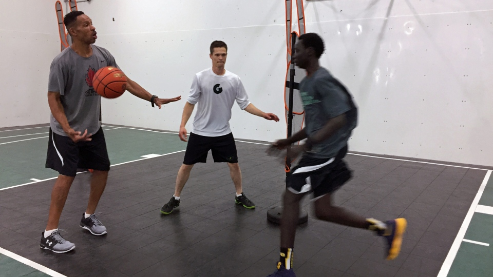 Sean Tyson, left, and Ian Kadlec, middle, work with a player as part of Greenwave United, an elite-level development program based in Saskatchewan. (Pat McKay/CTV Saskatoon)