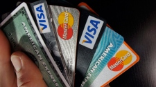 In this March 5, 2012, file photo, consumer credit cards are posed in North Andover, Mass. (AP Photo/Elise Amendola, File)