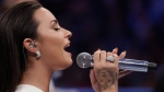 Demi Lovato sings the National Anthem before a super welterweight boxing match between Floyd Mayweather Jr. and Conor McGregor, Saturday, Aug. 26, 2017, in Las Vegas. (AP Photo/Isaac Brekken)