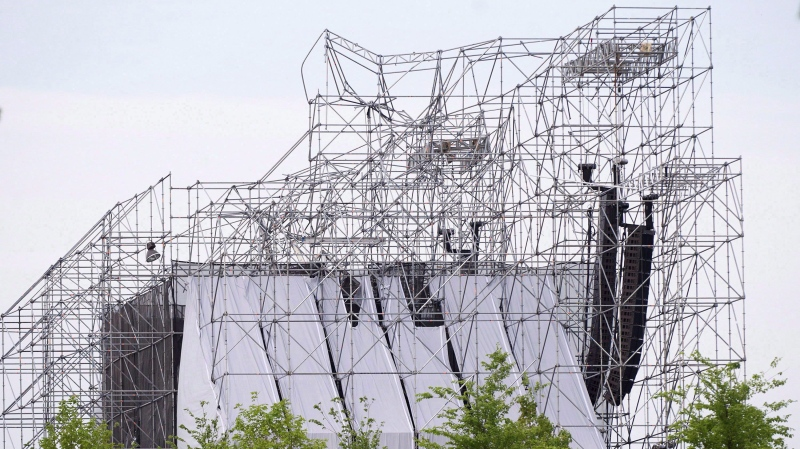 A collapsed stage is shown at a Radiohead concert at Downsview Park in Toronto on June 16, 2012. The band's drum technician Scott Johnson was killed in the incident. THE CANADIAN PRESS/Nathan Denette