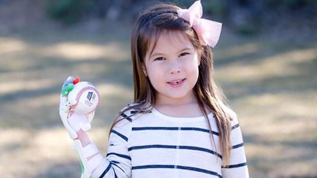 Hayley Dawson holds a baseball