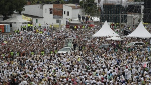People greet Pope Francis as he makes his way to the stage in his popemobile to celebrate Mass in Villavicencio, Colombia, on Sept. 8, 2017. (Andrew Medichini / AP)