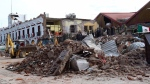 Soldiers remove debris from a partly collapsed municipal building after an earthquake in Juchitan, Oaxaca state, Mexico, Friday, Sept. 8, 2017. One of the most powerful earthquakes ever to strike Mexico has hit off its southern Pacific coast, killing at least 32 people, toppling houses, government offices and businesses. (AP Photo/Luis Alberto Cruz)