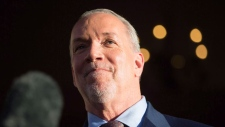 British Columbia Premier John Horgan pauses while speaking outside Government House in Victoria, B.C., on Thursday, June 29, 2017. THE CANADIAN PRESS/Darryl Dyck