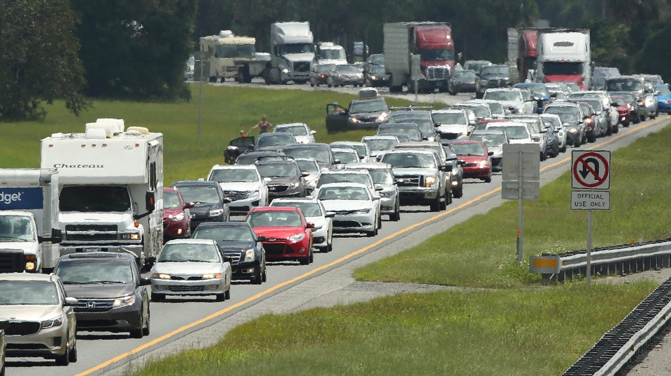 Traffic rolls at a crawl on the northbound lanes of Florida's Turnpike near the intersection of I-75 in Wildwood, Fla. on Friday, Sept. 8, 2017. (Stephen M. Dowell/Orlando Sentinel via AP)