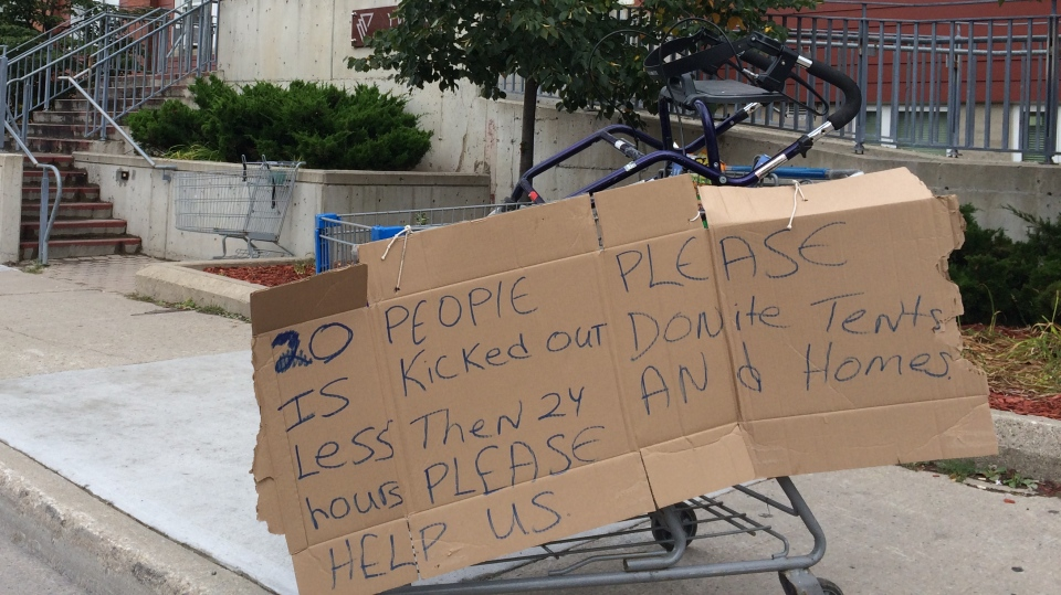 A sign was affixed to a shopping cart as part of a protest at the Mary's Place shelter in Kitchener. (Matt Harris / CTV Kitchener)