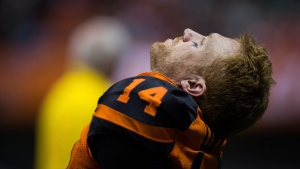 B.C. Lions' quarterback Travis Lulay sits on the sideline after leaving the game with an injury during the first half of a CFL football game against the Montreal Alouettes in Vancouver, B.C., on Friday September 8, 2017. THE CANADIAN PRESS/Darryl Dyck