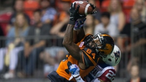 B.C. Lions' Emmanuel Arceneaux (84) makes a reception in the end zone for a touchdown as Montreal Alouettes' Greg Henderson defends during the first half of a CFL football game in Vancouver, B.C., on Friday Sept. 8, 2017. THE CANADIAN PRESS/Darryl Dyck