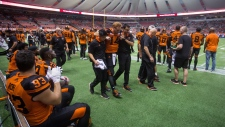 B.C. Lions' Travis Lulay is helped off the field